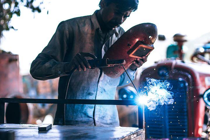 worker using a laser cutting machine